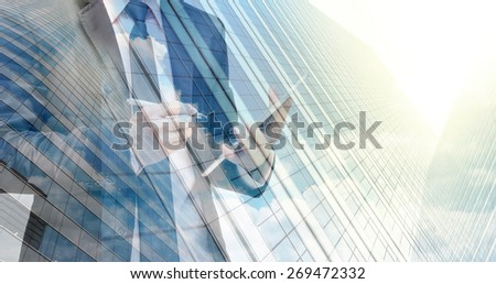Double exposure of businessman with cityscape building glass