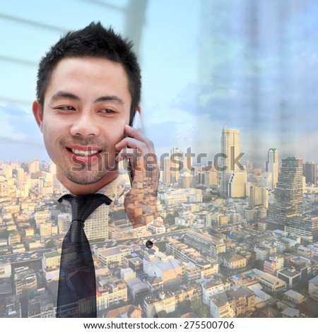Double exposure of businessman with phone on city background. - stock photo