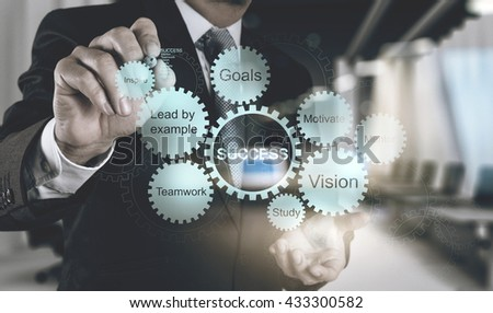 double exposure of businessman working with blue light gear to success as concept - stock photo