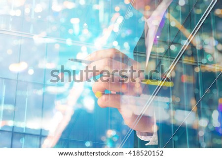 Double Exposure of Businessman writing with Building decorated with Glass - stock photo