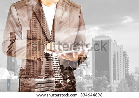 Double exposure of city and businessman with smartphone or mobilephone as Business development concept. - stock photo