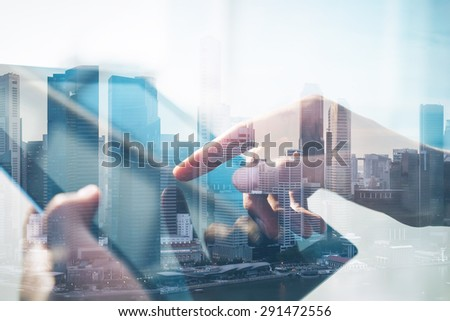 Double exposure of city and tablet - stock photo
