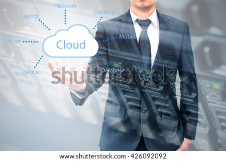Double exposure of cloud computing concept on hand of a businessman with servers computing technology in datacenter creative cloud concept - stock photo