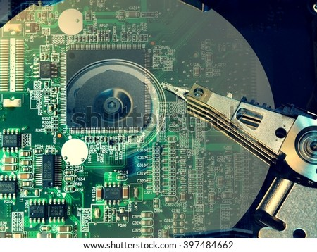 Double exposure of computer hard disk drive and electronic circuit - stock photo