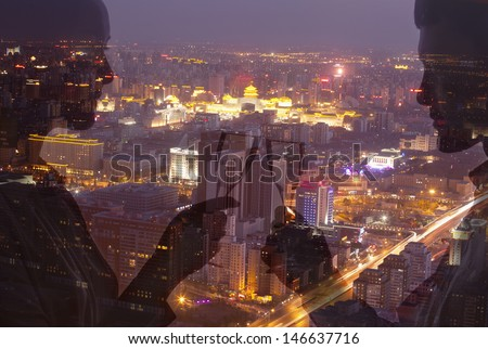 Double exposure of couple toasting with champagne flutes over night cityscape - stock photo