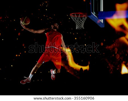 double exposure of  fire and  basketball  player,  sport player in action isolated on black background - stock photo