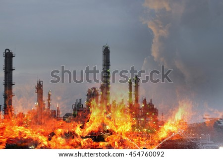 Double exposure of  Fire and refinery plant  , concept crisis a large oil refinery fire and emergency fire case. - stock photo