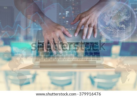 Double exposure of hand using the laptop with cityscape and financial graph on computer blurred background, Elements of this image furnished by NASA, education and business concept - stock photo