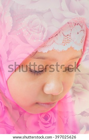 double exposure of little muslim girl in pink hi jab and rose