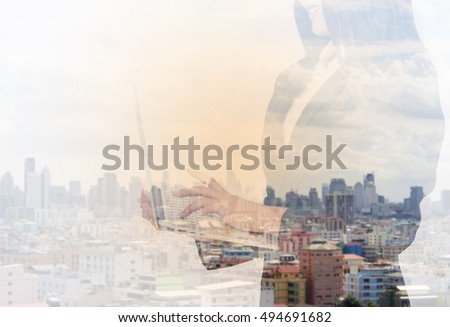 Double exposure of man trader dressed in corporate suit is analyzing financial market via laptop computer. Skilled businessman keyboarding e-mail letter while using net-book. High technology concept