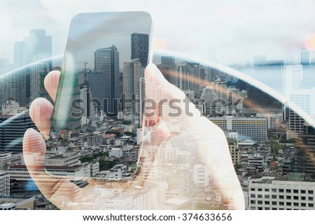 Double exposure of man using smart phone and cityscape background,  urban lifestyle and communication technology concept. - stock photo