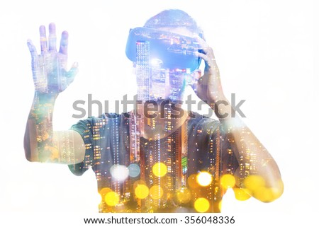 Double exposure of man using the virtual reality headset - stock photo