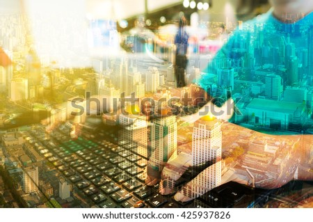 Double Exposure of Man with Loptop computer with Metro city Building. Planning concept