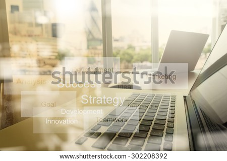double exposure of new modern laptop computer with businessman hand working and business strategy as concept - stock photo