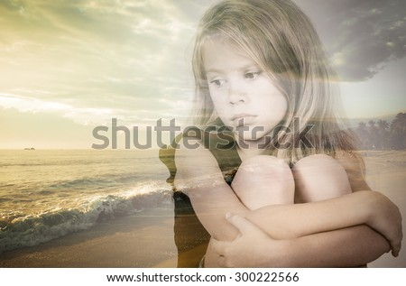 Double exposure of portrait of sad blond little girl and colorful sunset over the sea. - stock photo