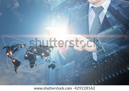Double exposure of professional businessman using cloud in smart phone with servers technology in data center and world map network connection in IT Business concept, world map from NASA - stock photo