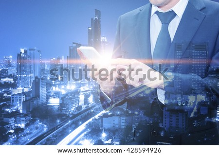 Double exposure of professional businessman using cloud technology in smart phone with servers technology in data center and network connection in IT Business technology concept - stock photo