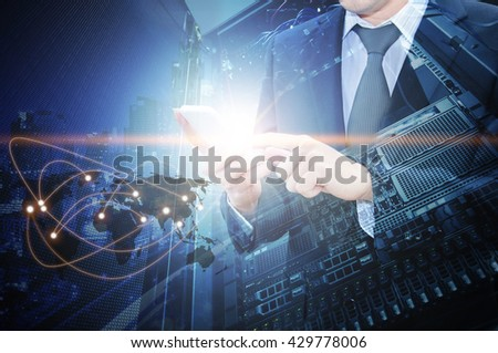 Double exposure of professional businessman using smart phone with servers technology in data center and world map network connection in IT Business concept, world map from NASA - stock photo
