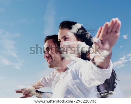 double exposure of romantic young couple and sky clouds