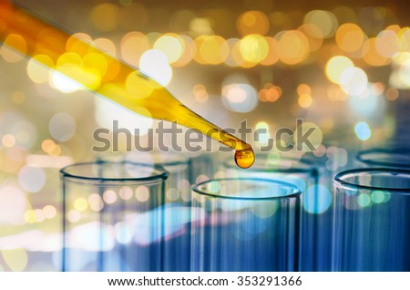 double exposure of science laboratory test tubes with bokeh - stock photo