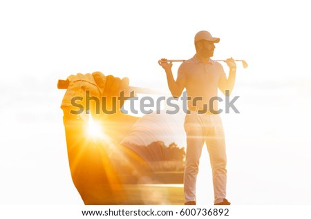 Double exposure of senior golf player holding club combined with green field
