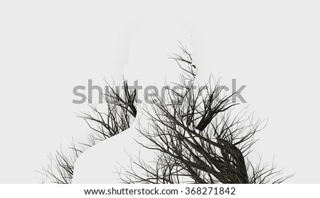 Double Exposure of silhouette and winter trees