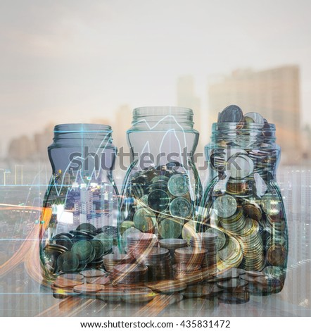 Double exposure of stack of coins and mix coins in clear bottle on blurred photo of cityscape and financial graph with cityscape background, Business Trading and investing concept - stock photo