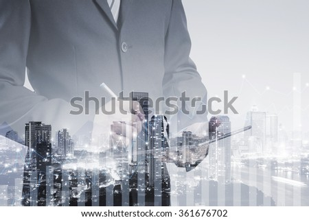 Double exposure of success businessman using digital tablet with city landscape background,business background - stock photo
