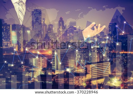 Double exposure of success businessman with Forex graph and an beautiful night view of the business city centre. A metaphor of international financial consulting.investment concept - stock photo