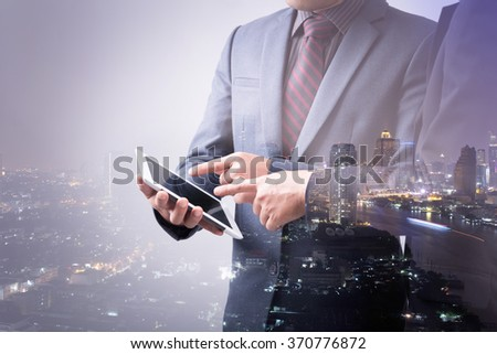 Double Exposure of Two Businessmen Dealing Business - stock photo
