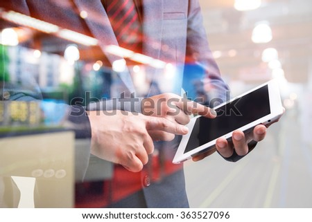 double exposure of two businessmen using tablet at meeting with blur people in shopping mall  - stock photo