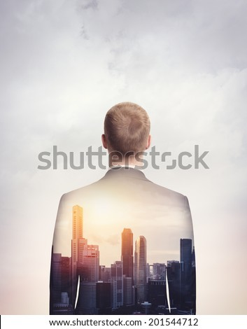 double exposure of young businessman and city - stock photo