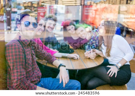 Double exposure of young people enjoying and having fun (image taken mostly behind glass reflection for desired look) - stock photo