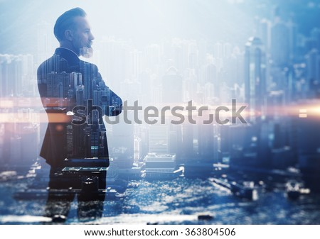 Double exposure photo a businessman and view of the city - stock photo