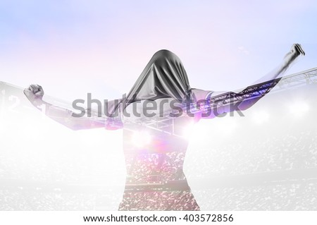 double exposure photo of stadium and soccer or football player celebrating goal with his jersey on head - stock photo