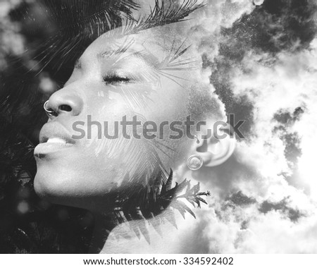 Double exposure portrait of african american woman combined with photograph of trees and sky - stock photo
