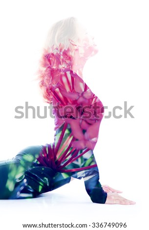 Double exposure portrait of attractive woman performing yoga asana, combined with photograph of a flower - stock photo