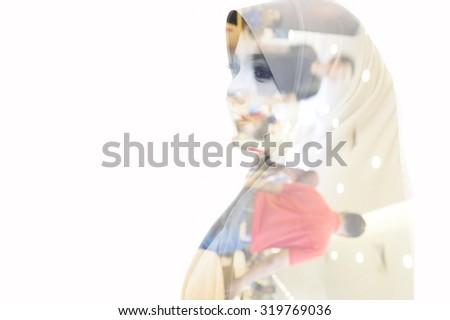 Double exposure portrait of beautiful Asian muslim woman wearing hijab on blurred background with bokeh and defocused lights