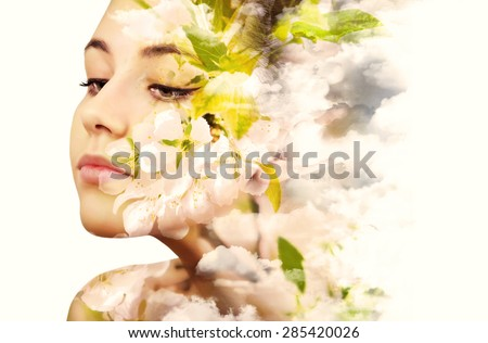 Double exposure portrait of young woman and blooming branch of the apple. - stock photo