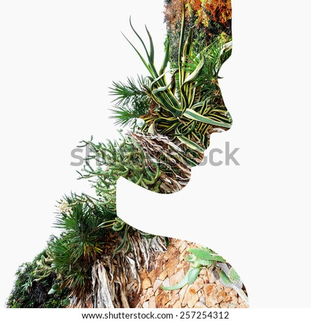 Double exposure portrait of young woman and tropical plants. - stock photo