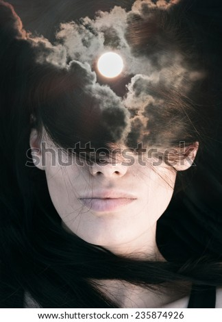 Double exposure portrait of young woman combined with photograph of sun among clouds - stock photo