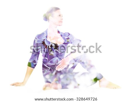 Double exposure portrait of young woman performing yoga asana, combined with photograph of flowers - stock photo
