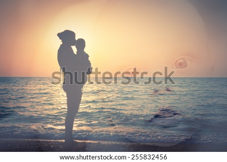 Double exposure, Silhouette of mother and child on the beach, and a child's face - stock photo