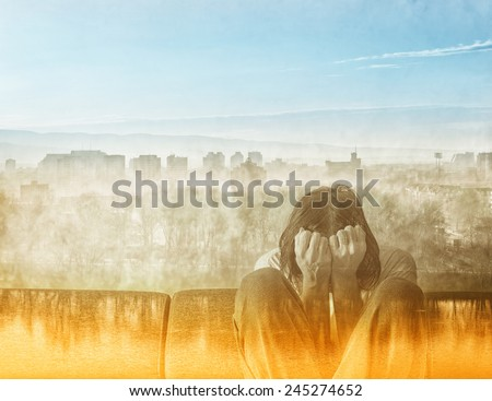 Double exposure Social Alienation Concept, Depressed Man covering face and crying in despair. - stock photo