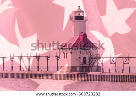 Double exposure St. Joseph north pier lighthouse along shoreline of Lake Michigan with American flag background - stock photo