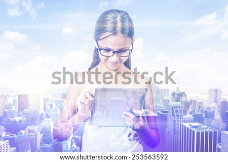 Double exposure teenager girl and city. Young student using digital tablet with city skyline skyscraper view background. Modern new technology communication concept  - stock photo