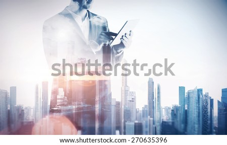 Double exposure with businessman using digital tablet. With special lighting effects - stock photo