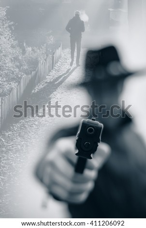 Double exposure with the concept of a person detective with a gun in the city