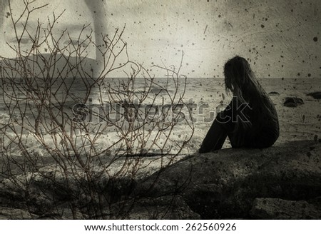 Double exposure young woman sitting on a rock ,Sad concept - stock photo