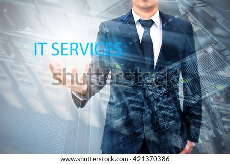 Double expsoure of businessman with servers technology in data center in IT services concept - stock photo